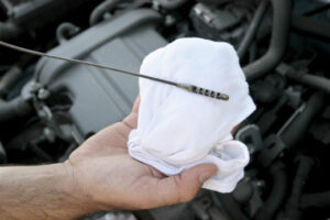 How are fluid levels checked in your car?